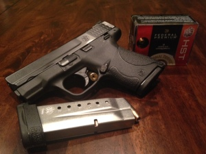 My new carry gun and ammo. M&P Shield and Federal HST